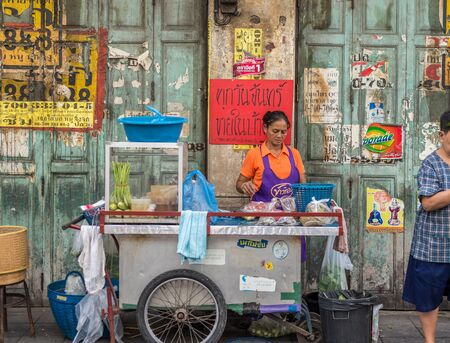 china town: Bangkok, Thailand - July 15, 2015 Unidentified street-food-seller in area of Yaowarat or Thailands China Town