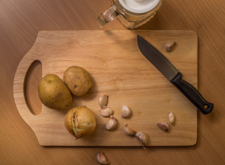 cutting: Some ingredients on cutting board in a kitchen.