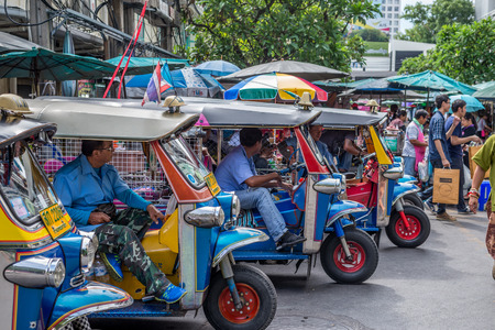 tha: Bangkok, Thailand - Sep 12, 2015 Unidentified driver of tricycle taxi or Tuk Tuk at Tha Prachan, the pier on the historic Rattanakosin Island on the eastern bank of the Chao Phraya Rive Editorial