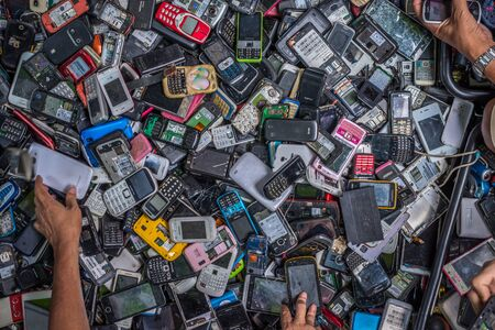 Bangkok, Thailand - Sep 12, 2015 Old and damage cellphones on sell on street in area of Yaowarat, the China town of Thailand