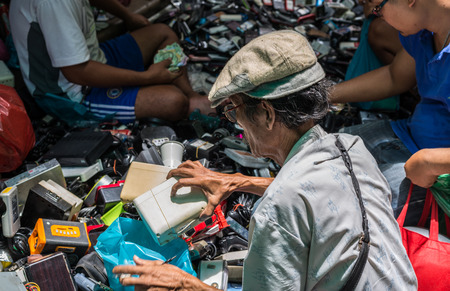 old items: Bangkok, Thailand - Sep 12, 2015 Unidentified old man is buying old and used stuffs on street of Yaowarat or China town of Thailand Editorial