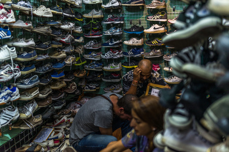 Bangkok, Thailand - Nov 14, 2015 Unidentified people in used shoes and sneaker store at Chatuchak, the biggest weekend market in South East Asia. Editoriali