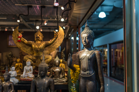 sculptor: Bangkok, Thailand - Nov 14, 2015 Shop of antique Buddha sculptor  for sell  in JJ Mall which located next to Chatuchak market. Editorial