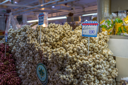 Bangkok, Thailand - Nov 14, 2015 Garlic and others herbs for sell at Or Tor Kor market, a well known place for fresh food, fruits and foods. Located next to Jatujak market.