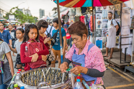 Bangkok, Thailand - Nov 14, 2015 Unidentified woman is selling local ice cream at Chatuchak, the biggest weekend market in South East Asia.