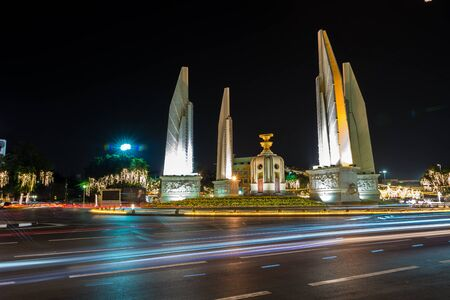 democracy Monument: Bangkok, Thailand. Democracy Monument at night. Located on the wide east-west Ratchadamnoen Klang Road, at the intersection of Dinso Road.