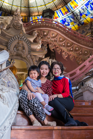 samut prakan: Samut Prakan, Thailand - Dec 28, 2015 Unidentified family in happy time at Erawan Museum. This place is closed to Bearing BTS Stationใ