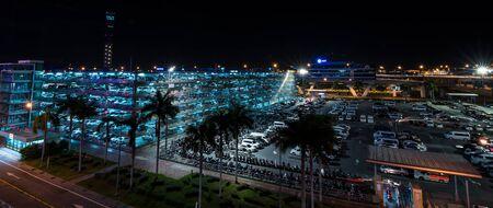 car lots: Nonthaburi, Thailand - Dec 7, 2015 Parking lot at Suvarnabhumi Airport at night.