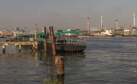 ozone: Samut Prakan, Thailand. Ferry at Bang Nam Pueng Pier, the place in area of Bangkajao which called the best ozone, located in opposite side of fatory zone.