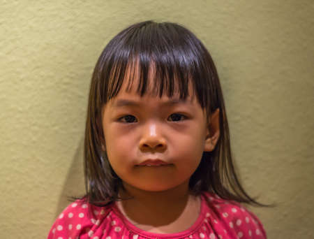 Asian toddler girl in face shot