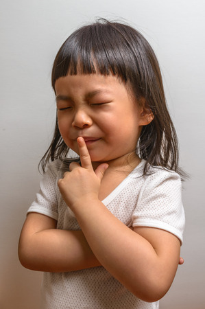 Little girl with gesture Stock Photo