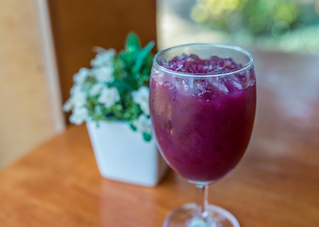 Glass of grape juice with ice