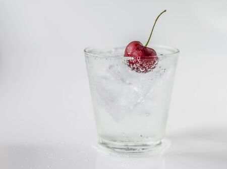 dept: Cherry in glass of soda and ice