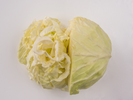 Half and chopped cabbage in heart shape Stock Photo