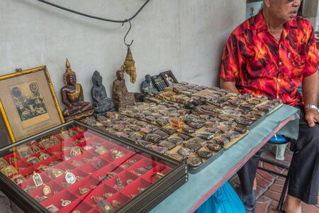 Bangkok, Thailand - Sep 4, 2016 Unidentified man sell amulet and religian item on street in Chinatown area or Yaowarat Editorial