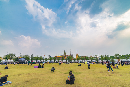 Bangkok, Thailand - Oct 18, 2016 Unidentified people are waiting to see the Royal Family that come to pray for The King IV at Sanam Luang in front of Wat Phra Kaew and the Grand Palace