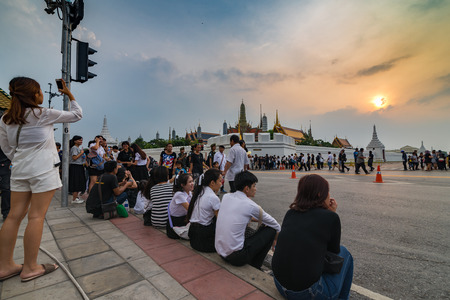Bangkok, Thailand - Oct 18, 2016 Unidentified people are waiting to see the Royal Family that come to pray for The King IV in front of Wat Phra Kaew and the Grand Palace
