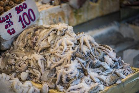 Octopus on sell on street food market of Thailand Stock Photo