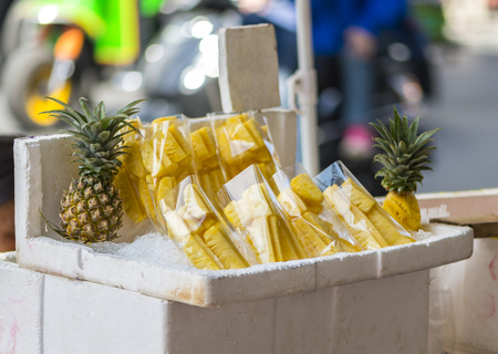 storage: Pine apple in plastic bag on street food of Yaowarat, Bangkok, Thailand Stock Photo