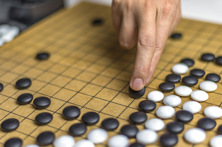 Playing Go or Igo, Chinese board game Stock Photo