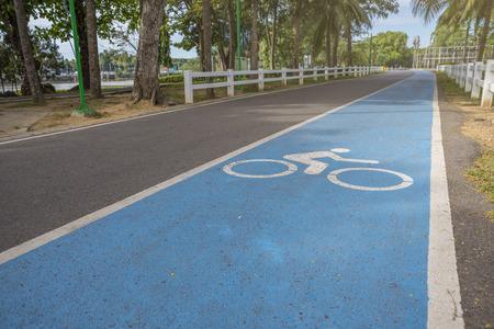 Perspective bike lane in park. Warm light in morning