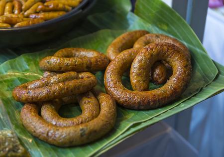 Sai ua or Northern Thai sausage on banana leaf for sell on street food of Thailand