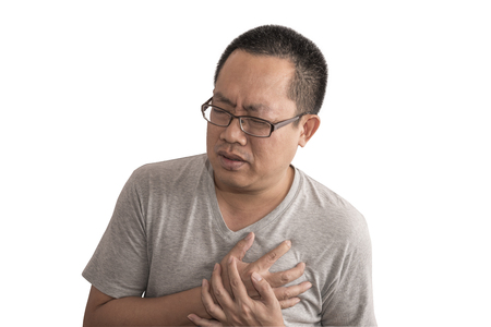 Asian man having chest pain  or heart attack. Image on isolated background. Man wear eyeglasses and short hair style. Stock fotó