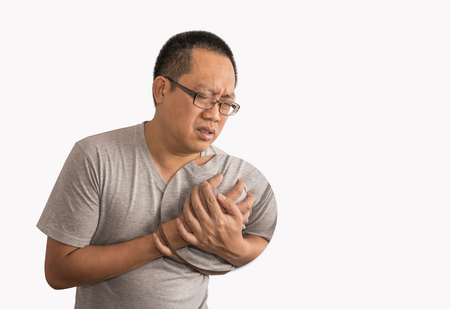 Asian man having heart attack. Focus on pain area by increase size bigger than usual. Image on isolated background. Stock fotó