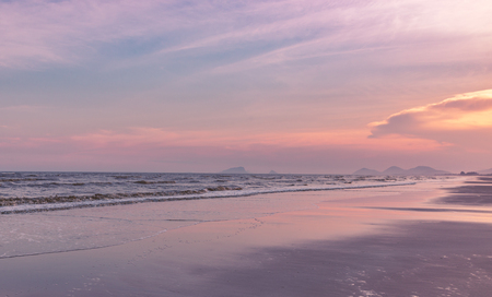 Colorful atmosphere on the beach in sunset time. Beautiful sky and reflex color on the beach. Blank space for text.