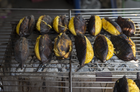 Huk Mook or Silver Bluggoe grilled. Huk Mook or Silver Bluggoe on hot grill. Tradition Thais snack. Image of local organic food market in Thailand.