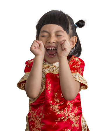 Happy Asian little girl celebrate Chinese dress. Red dress of traditional Chinese culture. Little girl with happy moment.