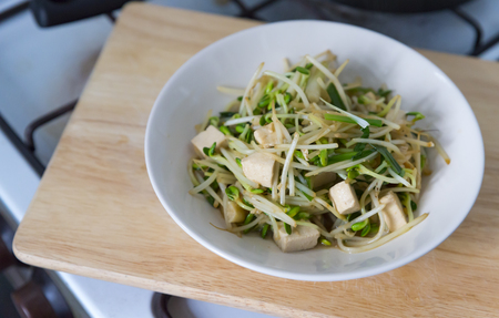 Healthy Asia meal, stir fried bean sprouts with tofu and green onions.