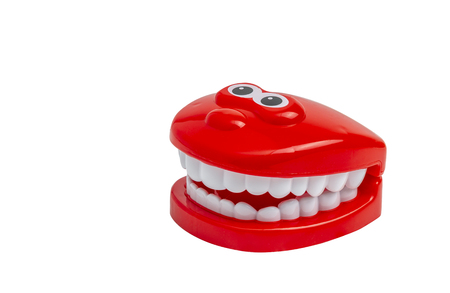 Cute toy teeth isolated on white background. Toy teeth with eyes. Stock Photo