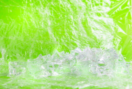 Fresh background with group of ice cube for product presentation in freshness or summer concept. Green background.