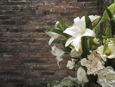 Beautiful flower for room decoration with vintage brick wall as blackdrop. Space for text. Stock fotó