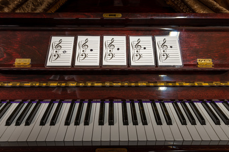 Flash cards of music note on old piano. Concept of learning.