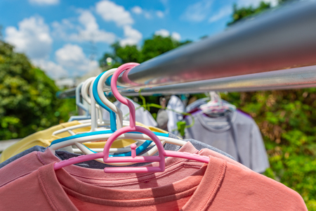 Drying clothes with hanger under the sun. Perspective view.