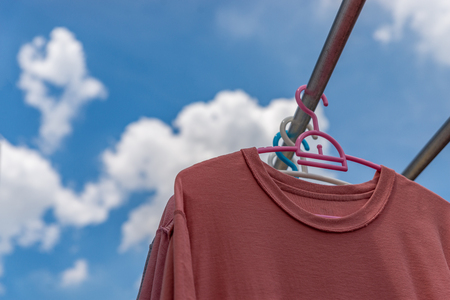 Drying t shirt under the sun. Blue sky with cloud. space for text. Stock fotó