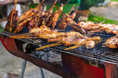 Chicken BBQ on stove on street food of Thailand Stock fotó