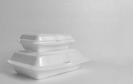 Two size of white foam food containers on white foam background. Perspective foam food container or food box for take away.