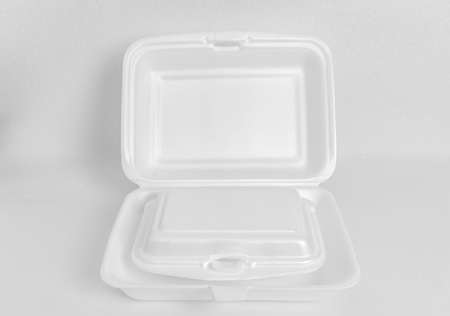 Two size foam food containers. Small container is in big container. Foam container on white foam background. Clipping path in file.