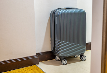 Modern small luggage in a room.