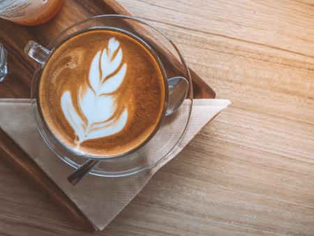 Top view hot latae coffee on wood trey