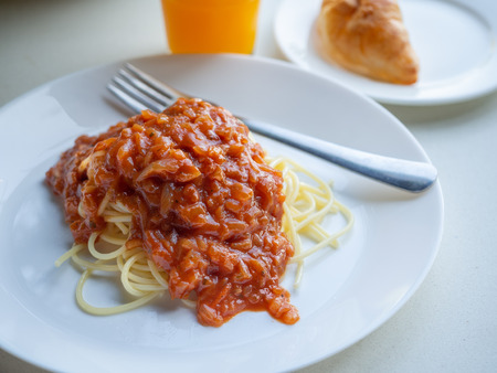 Close up spaghetti bolognese on whie table with natural light.
