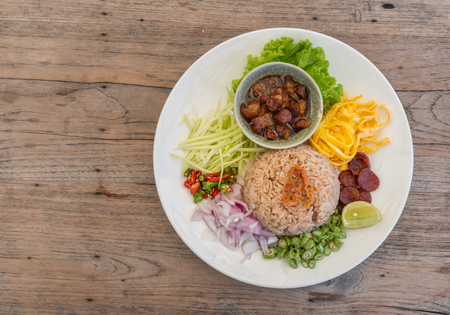 Top view Thailand food, Kaw Cook Kapee or Mixed rice with shrimp paste and eat with fresh vegetables, egg, sweet pork and more
