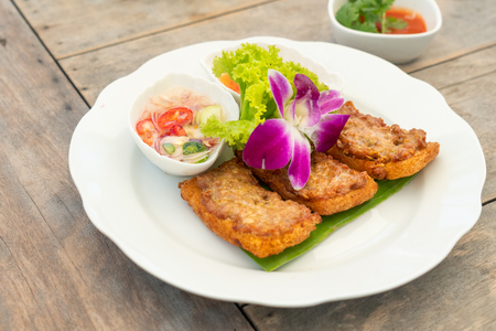Traditional Thailand snacks called Kanompung Na Moo or deep fried bread with pork. Selected focus food image.