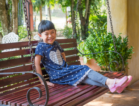 Charming Asian small girl with sincerely smile.