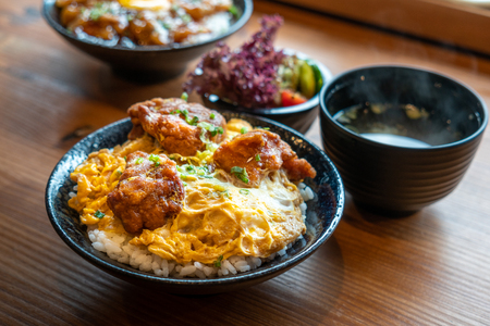 Bowl of Japanese food, fried chicken or called Karake boiled with egg and sauce over rice.