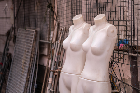 Two Mannequin when shop is closed in day time before open at night on street fashion shop of Bangkok, Thailand. Imagens