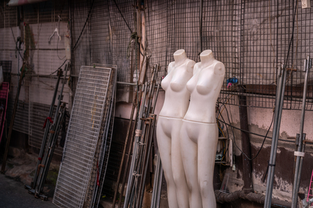 Two Mannequin when off hour on street fashion shop of Bangkok, Thailand.
